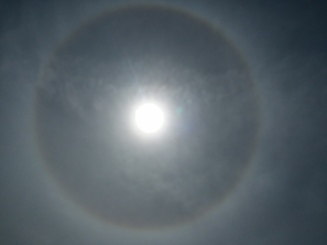 The ring around the sun is from ice crystals high up in the atmosphere, this signals rain or snow in the next 48 hours.
